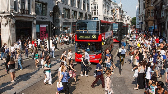London's Oxford Street restricts traffic primarily to buses and taxis, with widened footpaths for pedestrians (Source: Fast Company)