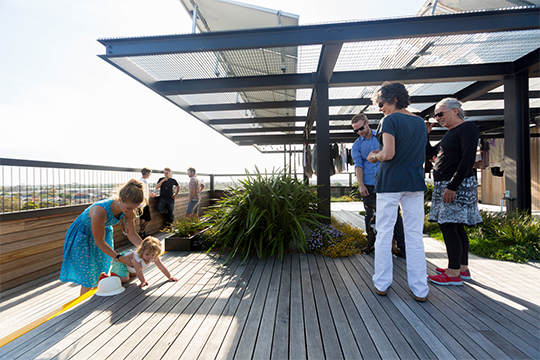 The development's shared rooftop laundry has proved a popular space for residents.