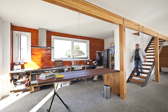 Exposed thermal massing helps to absorb and retain heat within the home (Zero Energy House)
