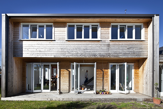 This north-facing facade has extensive glazing to capitalize on the heat of the sun (Zero Energy House).