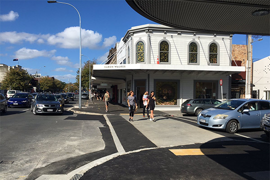A raised pedestrian table at the corner of Mackelvie Street and Ponsonby Road.
