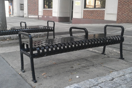 Street furniture such as this park been is designed to prevent its use by the homeless.
